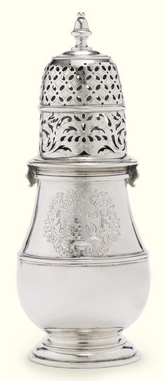 A large Queen Anne silver caster, Jonah Clifton, London, 1706 engraved with contemporary arms, fully marked on body, cover with maker and city mark only. height 8 in