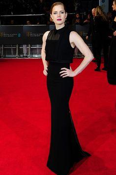 BAFTA 2014. La alfombra roja. Amy Adams, nominada como Mejor Actriz Principal por su trabajo en American Hustle, rindió tributó al país de los BAFTA con un diseño de una de las mejores embajadoras de Reino Unido, Victoria Bekcham.