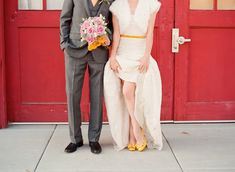 a pop of gold mixed with a Monique Lhuillier number makes for a really good looking combo. See the full wedding in our Fashion & Beauty Mag http://issuu.com/stylemepretty/docs/stylemepretty_fashion_beauty_magazine/128  Photography by yanphoto.com, Floral Design by edwardsgreenhouse.com