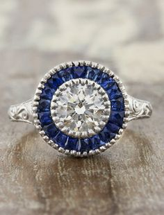 Joanna is a vintage inspired sapphire halo engagement ring with migraine and filigree by Ken + Dana Design.