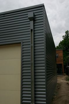 Corrugated steel siding