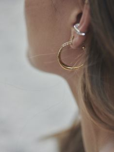 Chunky, on trend, sparkling hoops. Inspired by the smooth curves of seashells. Fashion Earrings, Fashion Jewelry, Cleaning Silver Jewelry, Metal Fashion, Treasure Island, White Topaz, Seashells, Precious Metals, Sterling Silver Jewelry