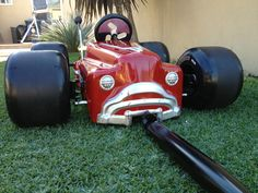 my little boy's hot rodded out pull wagon made from sad face pedal car