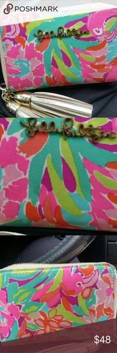Lilly pulitzer wallet  wristlet In awesome condition used it a couple of times! Nothing is wrong with it. Just bought a new one so I want to get rid of this one. It just has a Tiny stain on the front that comes off once washed or clean! Lilly Pulitzer Bags Clutches & Wristlets