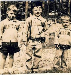 Dan'l Boone[s]  The 50s thing of dressing your kids up in costume. All alike. Well I suppose that that impulse is timeless. Daniel Boone. Jim was the only one with the coonskin cap. I remember really liking the fringe-y jacket.