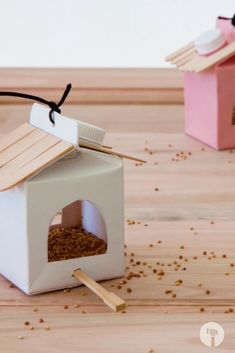 Turn old yoghurt boxes to bird feeders. All you need is some spray paint, chopsticks, ice cream sticks. Fill with some seeds and witness all sorts of flying beauties visit your garden. Chopsticks, All You Need Is, Bird Feeders, Fill, Seeds, Boxes, Ice Cream, Paint, Garden