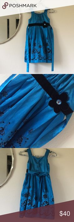 Black Velvet Trim Girl's Aqua Luster Party Gown 7 Perfect holiday Christmas or Hanukkah party girl's dress. Excellent condition. Smoke free home. No flaws. Glitter on the roses. Tie a bow J the back. Black velvet ribbon and flower. Poof! Cupcake. Layer and Tulle underwear for flare. Buttons up the back. Easter, church, temple, birthday celebration. JOAN MICHELLE designer.  Shell is 73% polyester 27% nylon. Made in Vietnam. Dress F Justice Dresses Formal