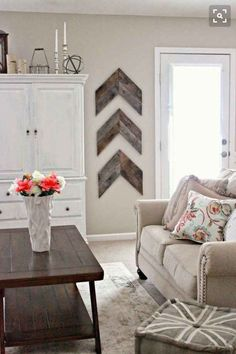 Living Room decor - rustic farmhouse style. Rustic reclaimed wood arrows, painted white armoire, neutral color palette.