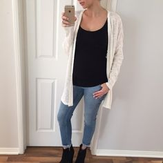 """Last Item • Beautiful Ivory Knit Cardigan Such a super cozy sweater. Great quality fabric - simi light weight. Pairs beautiful with light and dark shades. Perfect piece for year round to own. I'm modeling the M/L. Size available: M/L. 85% rayon 15% spandex. M/L= 29"""" long • 25"""" chest. {{ Please do not purchase this listing, I will create you a new one }} Sweaters Cardigans"""