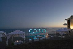 The CW took over a Malibu lot on 300 feet of Pacific Ocean frontage for a 2008 premiere party for 90210, where an illuminated sign of the sh... Photo: Joel H. Mark