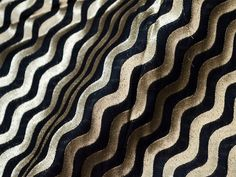 This is a beautiful pure benarse silk brocade wave pattern design fabric in Black and Gold. The fabric illustrate golden woven waves on blue background.  You can use this fabric to make Dresses,...