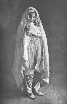 Woman from Peshawar.  Picture from the book, People of all Nations. Taken by Holmes and Co. Peshawar.
