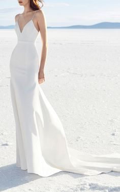 """This **Alex Perry Bridal** Cameron Satin Trumpet Gown""""featuresa fitted silhouette with a low v neckline, spaghetti straps and gathered flare skirt."""