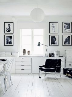 Beautiful black and white wall gallery decoration at this dining room with black & white photo albums at white wall and white cabinet, dining chairs and table, a black arm chair with elegance accessories. It's a modern and classic interior wall gallery decoration idea. http://www.urbanroad.com.au/