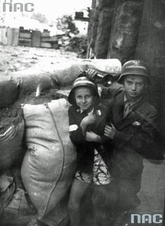 Young boys during the Warsaw Uprising 1944. The national liberation uprising attended hundreds of children. The youngest being sold insurgent newspapers and served as liaisons or guides in the sewers. The older of the gun in his hand fighting with the enemy on the front lines.