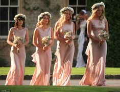 millie mackintosh bridesmaids wearing coral column bias cut gowns from Ghost, with long loose waved hair and floral crowns.