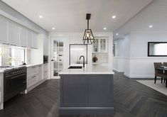 Our Managing Director talks with Crisp white lines and horizontal cladding is our take on this hallmark look, as featured at our Calderwood Display. Open Plan Kitchen Living Room, Home Decor Kitchen, Interior Design Living Room, Home Kitchens, Kitchen Interior, Kitchen Ideas, Hamptons Kitchen, Hamptons House, The Hamptons