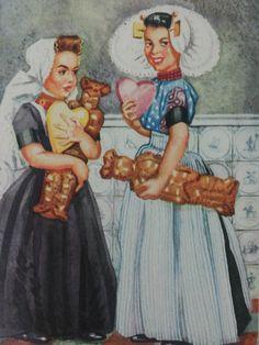 Ansichtkaart met twee Zeeuwse meiden, in hun handen speculaaspoppen (vrijers) en harten.