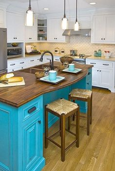 a pop color in the kitchen!! Not this bright but like the idea of painting the island a different color!