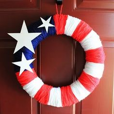 Simple patriotic wreath. Just wrap a foam wreath form with yarn and decorate with cardboard stars.