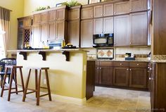 Browse through pictures of kitchens in this gallery featuring traditional walnut-colored dark wood cabinets. Walnut Kitchen Cabinets, Dark Wood Cabinets, Updated Kitchen, New Kitchen, Kitchen Ideas, Custom Countertops, Dark Wood Kitchens, Kitchen Gallery, Custom Kitchens