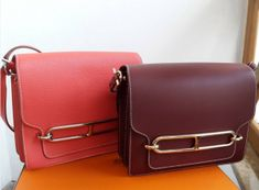 Hermes Red and Rubis Roulis Bags