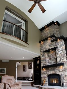 Fireplace, Traditional Family Room Wirh Exciting Fireplace Renovation Also Wooden Wall Fire Surround Also Black Modern Mantelpiece And Cream Mod Light Brown Chair Also Modern Indoor Balcony With Classic Railings: Simple and Beautiful Fireplace Facelift
