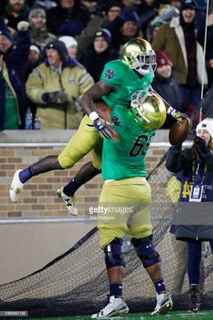 c23630f35 Dexter Williams of the Notre Dame Fighting Irish is lifted up by.