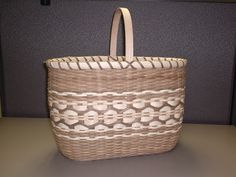 One of my favorite, but most difficult baskets. Made with smoked reed. Auctioned for fundraiser for my chorus.