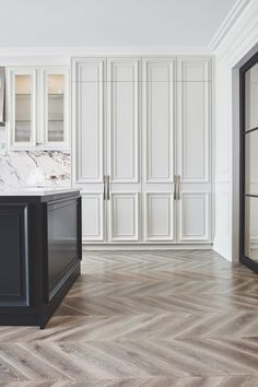 White and bright elegant kitchen interior design with wood herringbone pattern floors and white beveled cabinets — Blakes London Architecture Renovation, Home Renovation, Home Remodeling, Kitchen Remodeling, Home Luxury, Black Kitchens, Elegant Kitchens, Luxury Kitchens, Beautiful Kitchens