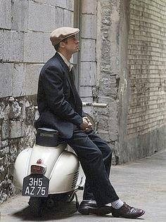 Brad Pitt on a scooter