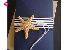 O un elemento que vaya con el tipo de boda. Por ejemplo una estrella de mar.: