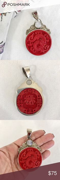 SAJEN sterling silver & cinnabar pendant Gorgeous. Ornate 925 sterling silver pendant with large carved (front and back) cinnabar disc. Moonstone (I think it's moonstone!) cabochon and smaller faceted garnet. Marked / stamped inside bale. In excellent used condition. Very faint wear throughout with no flaws. PENDANT ONLY; CHAIN NOT INCLUDED. A beautiful collector's piece. SAJEN Jewelry Necklaces