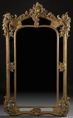 A LOUIS XV STYLE CARVED WOOD, GILT AND MOLDED GESSO BEVELED GLASS MIRROR 19th century, with rectangular dressing mirror enclosed within a carved and scrolling reticulated framework containing 8 mirrored panels highlighted in carved gilt floral overlays. Jackson's International Auctioneers and Appraisers