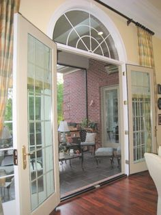 Great room French doors opening on to screened in porch