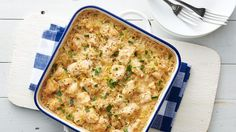 This all-in-one Parmesan crusted chicken and rice bake makes an easy and delicious dinner; add artichoke hearts for a little touch of veggie.