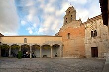 Real Monasterio de Santa Clara de Tordesillas in Castile, site of Juana's imprisonment.  Joanna had her youngest daughter, Catherine of Austria, with her during Ferdinand II's time as regent, 1507–1516. Her older daughter, Eleanor of Austria, had created a semblance of a household within the convent rooms.