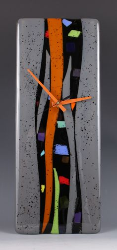 """""""Colorwaves"""" Fused Glass Clock can be customized with your own colors to match any decor. Handmade in Michigan. 6.5"""" x 16"""" $219. includes free shipping. ninacambron.com"""