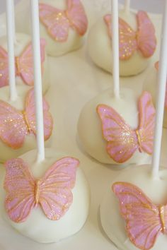 Butterfly cake pops - Butterflies made from fondant and hand painted with various luster dusts on vanilla cake pops.