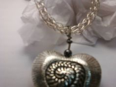 sterling silver viking knit necklace with pewter focal heart pendant and hematite beads.