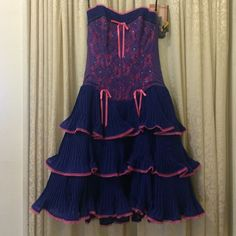 Strapless betsey Johnson party dress This is one of the most fun betsey party dresses with lots of ruffles for movement and dancing!!! Beautiful purple and pink strapless dress with sweetheart neckline and adjustable halter strap option. Has sequin detailed corset style top with boning and sheer mesh back with zipper and eyelet closure. Perfect for prom or any party! Betsey Johnson Dresses Strapless