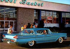 "A ""hypercolor"" 1959 Mercury advertisement shot in front of a Los Angeles Market Basket supermarket"