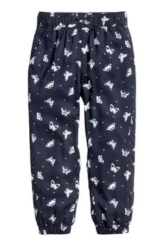 Patterned pull-on trousers - Dark blue/Butterflies - Kids | H&M