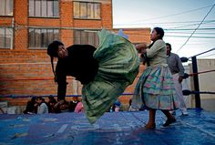 Cholitas luchadoras, kicking ass in full skirts.