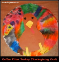 Need #Thanksgiving #decoration inspiration? Try making one of these #coffee filter #turkeys from @StockpilingMoms!
