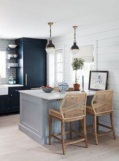 Kitchen stools offer a mod touch with a nautical twist, pairing perfectly with the clean look of the kitchen,which was designed by Will.