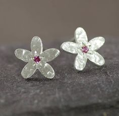 "I've just found Silver And Pink Sapphire Earrings. A beautiful hand made pair of flower ear studs,set in a ""gipsy"" style setting,with a textured finish.. £85.00"