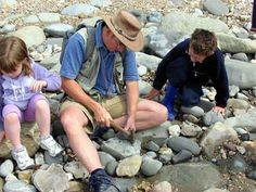 Chris with Children on a Fossil walk