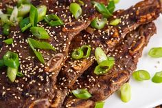 Kalbi:  2 pounds short ribs (trimmed)  1/4 cup soy sauce  2 tablespoons brown sugar  1 tablespoon sesame oil  4 cloves garlic (chopped)  1 inch ginger (grated)  4 green onions (sliced)  1/2 onion (grated)  1 Asian pear (grated)  1 tablespoon sesame seeds (toasted and crushed)