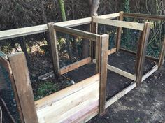 DIY 3-section compost bin/heap. Made with wire netting and scrap timber. Wood was from old roofing timbers, old pine floorboards and pallets all taken from skips. For front slats, grooves were cut with a wood router, but can be made in other ways. Mesh held together by pinning between two wooden pieces with screws but can use a staple gun or similar. 3 metres across, 120cm depth, 105 cm tall. Front posts are 10cm taller than back as had a step in ground surface. Works well as I could connect…